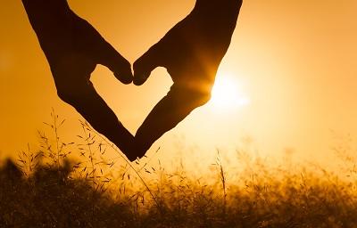 Heart against beautiful sunset.